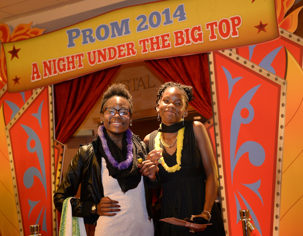 . DENVER, CO - JUNE 13: Cassandra Thrower-Smith, left, and her sister Nephraterie, right, posed for a photograph after the prom Friday night. Cassandra had a heart transplant two years ago at Children\'s Hospital. Children\'s Hospital hosted a prom for teens that might have missed their regular prom due to medical issues. The event was held at the Double Tree Hotel Friday night, June 13, 2014. The prom provides patients to have the opportunity to experience one of the biggest rites of teen passage. (Photo by Karl Gehring/The Denver Post)