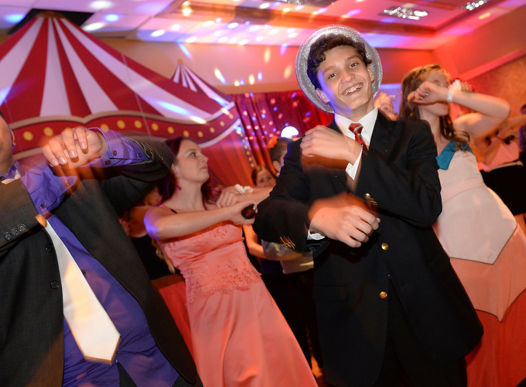 . DENVER, CO - JUNE 13: Zach Miller, age 15, hit the dance floor at the Children\'s Hospital Prom Night Friday night.  Children\'s Hospital hosted a prom for teens that might have missed their regular prom due to medical issues. The event was held at the Double Tree Hotel Friday night, June 13, 2014. The prom provides patients to have the opportunity to experience one of the biggest rites of teen passage. (Photo by Karl Gehring/The Denver Post)