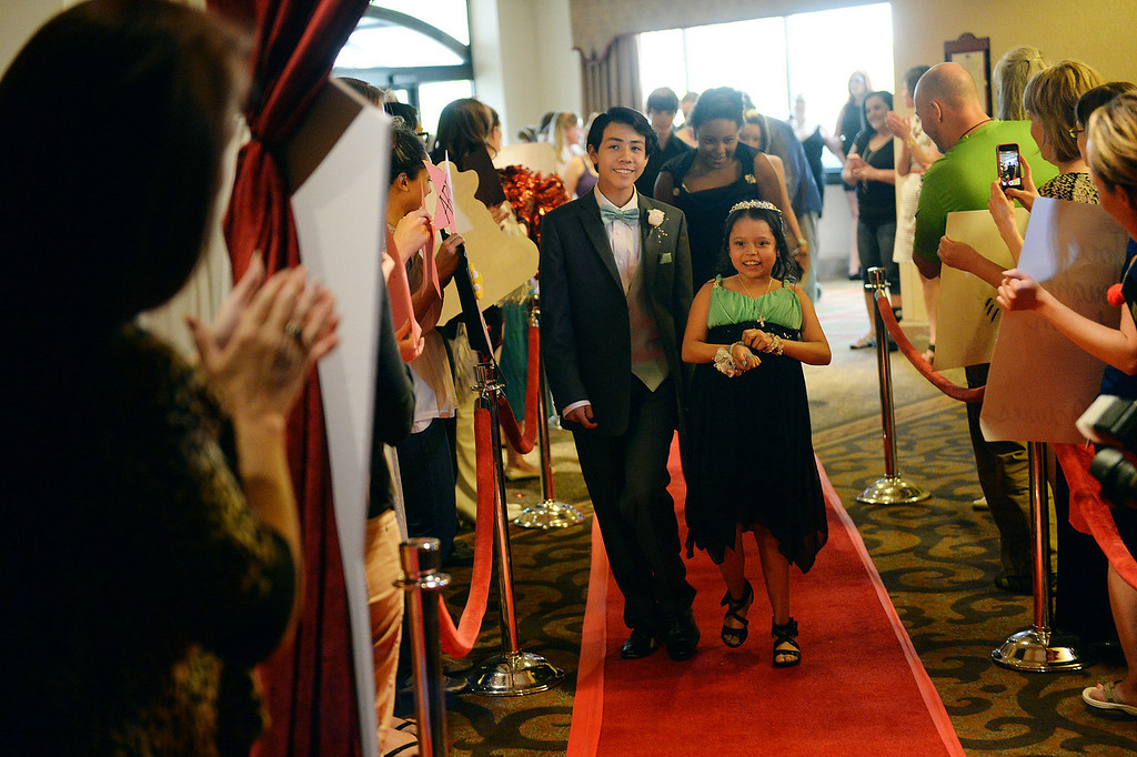 . DENVER, CO - JUNE 13: Matt Deleon, age 14, left, escorted his cousin Amaya Martinez, age 14, right, on the red carpet Friday night. Children\'s Hospital hosted a prom for teens that might have missed their regular prom due to medical issues. The event was held at the Double Tree Hotel Friday night, June 13, 2014. The prom provides patients to have the opportunity to experience one of the biggest rites of teen passage. (Photo by Karl Gehring/The Denver Post)