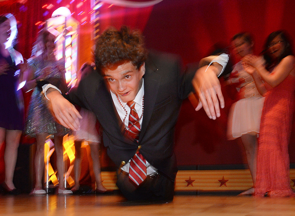 """. DENVER, CO - JUNE 13: Zach Miller, age 15, did the \""""Worm\"""" across the dance floor Friday night. Children\'s Hospital hosted a prom for teens that might have missed their regular prom due to medical issues. Miller has a mild form of cerebral palsy. The event was held at the Double Tree Hotel Friday night, June 13, 2014. The prom provides patients to have the opportunity to experience one of the biggest rites of teen passage. (Photo by Karl Gehring/The Denver Post)"""