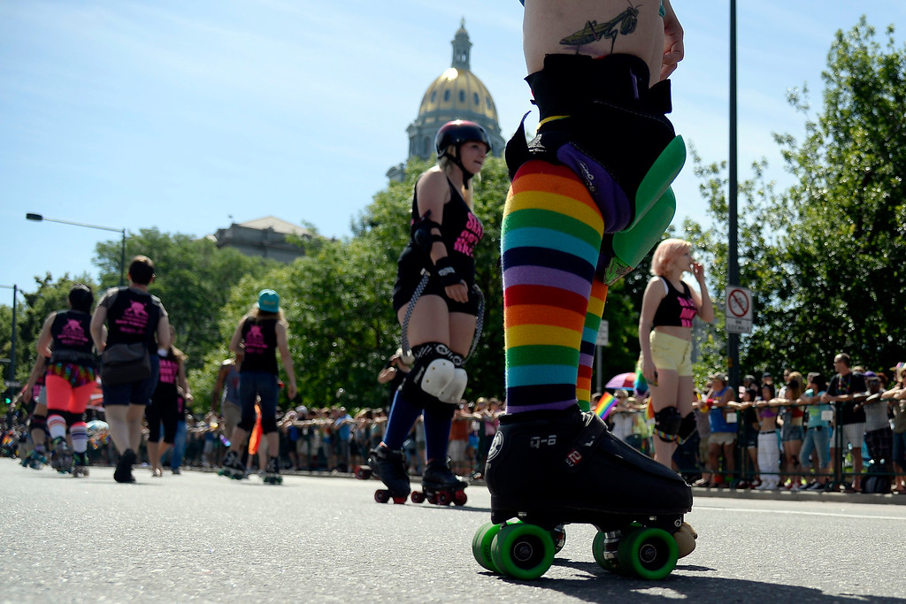. DENVER, CO - JUNE 22: Members of Rocky Mountain Roller Girls skate near Civic Center Park during PrideFest 2014 in downtown Denver. Thousands of people gathered in the city to enjoy a bevy of events including dancing, food and music on Sunday, June 22, 2014. (Photo by AAron Ontiveroz/The Denver Post)