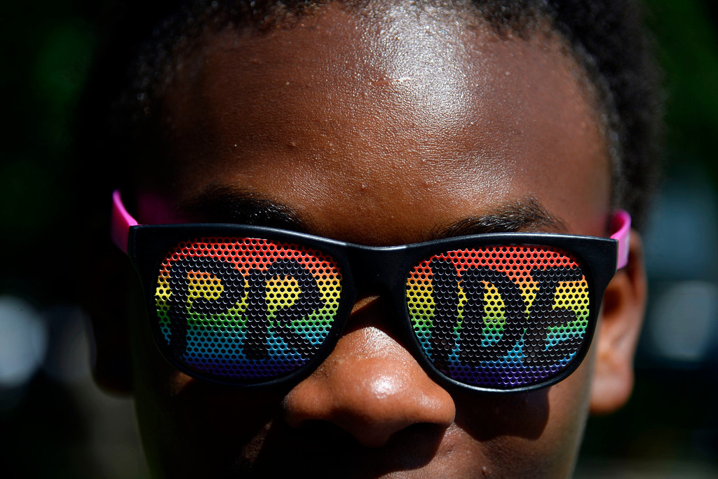 . DENVER, CO - JUNE 22: A young girl (who asked not to give her name) sports a pair of PRIDE glasses during PrideFest 2014 in downtown Denver. Thousands of people gathered in the city to enjoy a bevy of events including dancing, food and music on Sunday, June 22, 2014. (Photo by AAron Ontiveroz/The Denver Post)