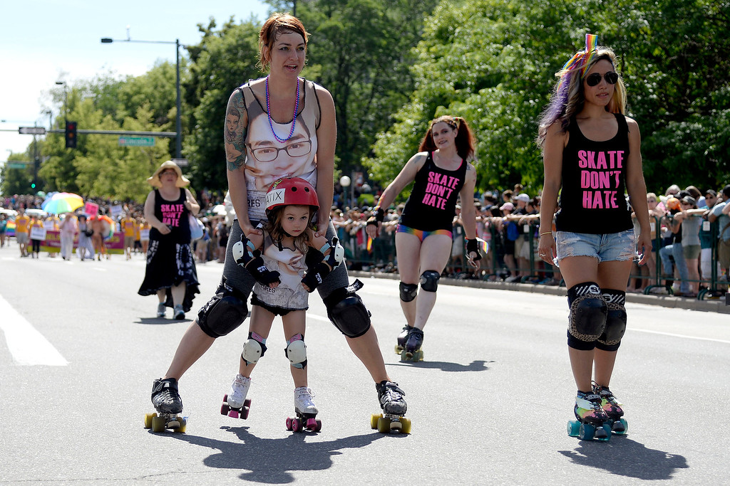 . DENVER, CO - JUNE 22: Patrice Loberg of the Rocky Mountain Roller Girls pushes her daughter, Josie, 3, during PrideFest 2014 in downtown Denver. Thousands of people gathered in the city to enjoy a bevy of events including dancing, food and music on Sunday, June 22, 2014. (Photo by AAron Ontiveroz/The Denver Post)