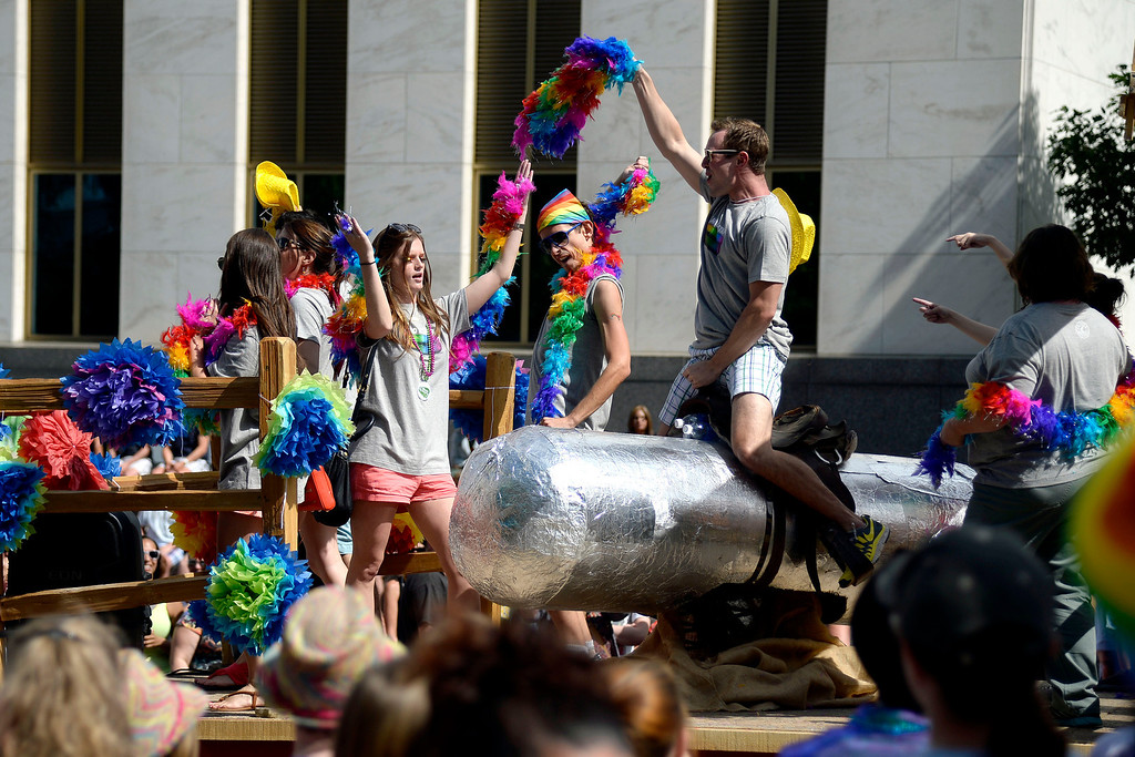 . DENVER, CO - JUNE 22: A man rides a large novelty burrito as the parade passes onlookers on Colfax Avenue near the state capitol during PrideFest 2014 in downtown Denver. Thousands of people gathered in the city to enjoy a bevy of events including dancing, food and music on Sunday, June 22, 2014. (Photo by AAron Ontiveroz/The Denver Post)