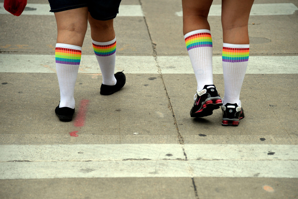 . DENVER, CO - JUNE 22: Tiffany Duncan (right) and Ernestine Lopez rock pride tube socks during PrideFest 2014 in downtown Denver. Thousands of people gathered in the city to enjoy a bevy of events including dancing, food and music on Sunday, June 22, 2014. (Photo by AAron Ontiveroz/The Denver Post)