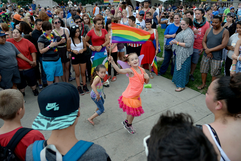 . DENVER, CO - JUNE 22: Kailee Valentine, 6 (with flag), dances with Armani Montez, 5, during PrideFest 2014 in downtown Denver. Thousands of people gathered in the city to enjoy a bevy of events including dancing, food and music on Sunday, June 22, 2014. (Photo by AAron Ontiveroz/The Denver Post)