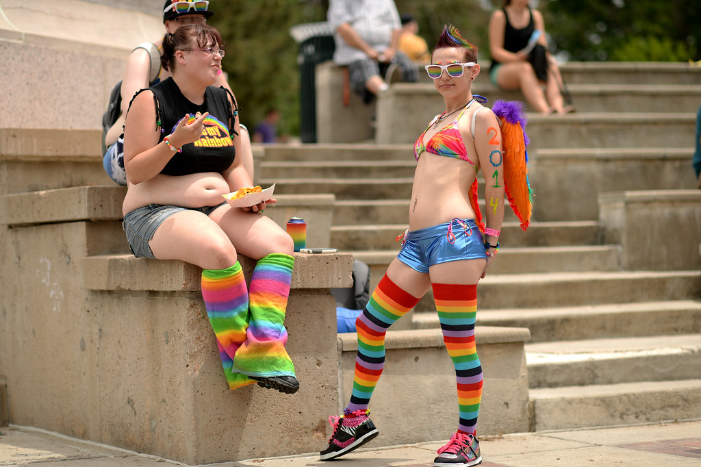 . DENVER JUNE 21: Stephanie Hildebrandt of Denver, right, with her friend Jonnie Deherrera, left, and Hildebrandt\'s partner Amanda Reno, top left, attend the 2014 Denver Pridefest at Civic Center Park in Denver, Colorado June 21, 2014. (Photo by Hyoung Chang/The Denver Post)