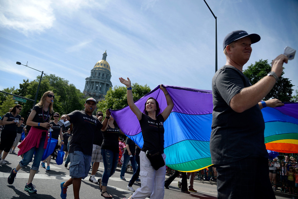 . DENVER, CO - JUNE 22: Representatives of United carry a large flag near the state capitol during PrideFest 2014 in downtown Denver. Thousands of people gathered in the city to enjoy a bevy of events including dancing, food and music on Sunday, June 22, 2014. (Photo by AAron Ontiveroz/The Denver Post)