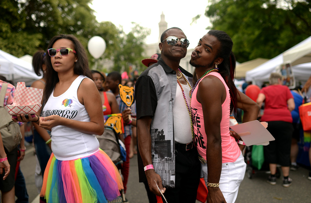 . DENVER JUNE 21: Damien Flowers, right, celebrates the 2014 Denver Pridefest with Patrick Staten of Denver at Civic Center Park in Denver, Colorado June 21, 2014. (Photo by Hyoung Chang/The Denver Post)
