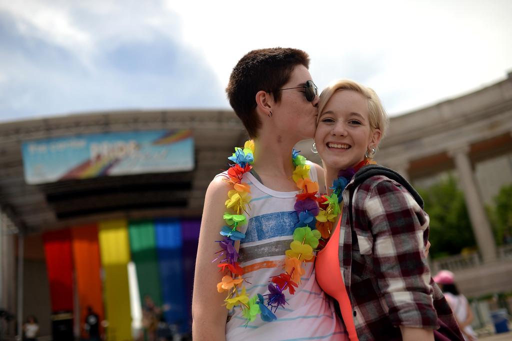 . DENVER JUNE 21: Ky Gentile, left, kiss her partner Taylor Little of Broomfield at Civic Center Park in Denver, Colorado June 21, 2014. The 2014 Denver Pridefest kicks off with many events. (Photo by Hyoung Chang/The Denver Post)