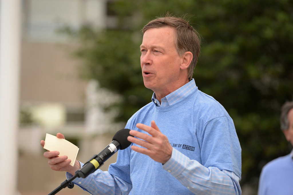 """. Gov. John Hickenlooper welcomes Chelsea Clinton at a press conference to kick off \""""Day of Action\"""" in Denver June 22, 2014, ahead of CGI America. Volunteers worked with six nonprofit organizations in the Denver metro area including the Boys & Girls clubs, Denver Parks and Recreation, Food Bank of the Rockies, Habitat for Humanity, Mi Casa Resource Center and Project C.U.R.E (Photo by John Leyba/The Denver Post)"""