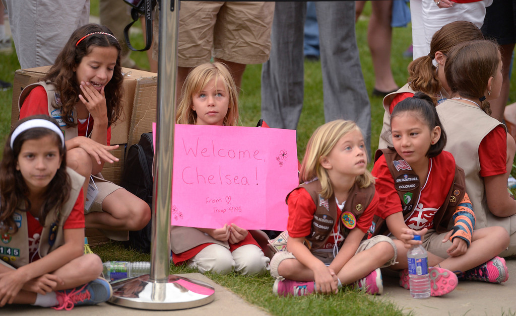 """. Girl Scout Emma Harma, 10, holds up a sign as the rest of Troop 4145 patiently wait the arrival of Chelsea Clinton on Sunday, June 22, 2014. Clinton held a press conference to kick off \""""Day of Action\"""" in Denver June 22, 2014, ahead of CGI America. Volunteers worked with six nonprofit organizations in the Denver metro area including the Boys & Girls clubs, Denver Parks and Recreation, Food Bank of the Rockies, Habitat for Humanity, Mi Casa Resource Center and Project C.U.R.E. (Photo by John Leyba/The Denver Post)"""