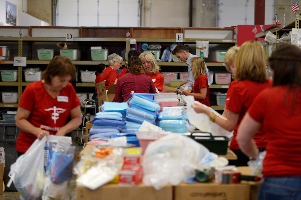 . Project C.U.R.E. workers put together Medical Supplies and Equipment in boxes to be shipped out.   (Photo by John Leyba/The Denver Post)