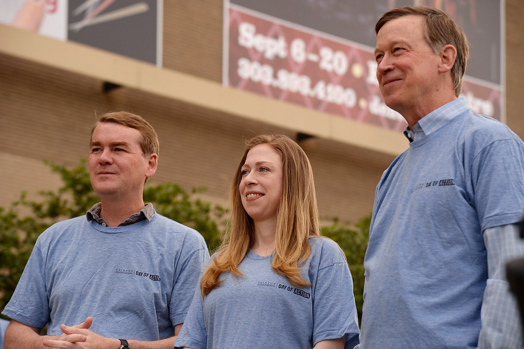 """. Senator Michael Bennet stands with Chelsea Clinton and Gov. John Hickenlooper during a press conference to kick off \""""Day of Action\"""" in Denver June 22, 2014 ahead of CGI America.  (Photo by John Leyba/The Denver Post)"""