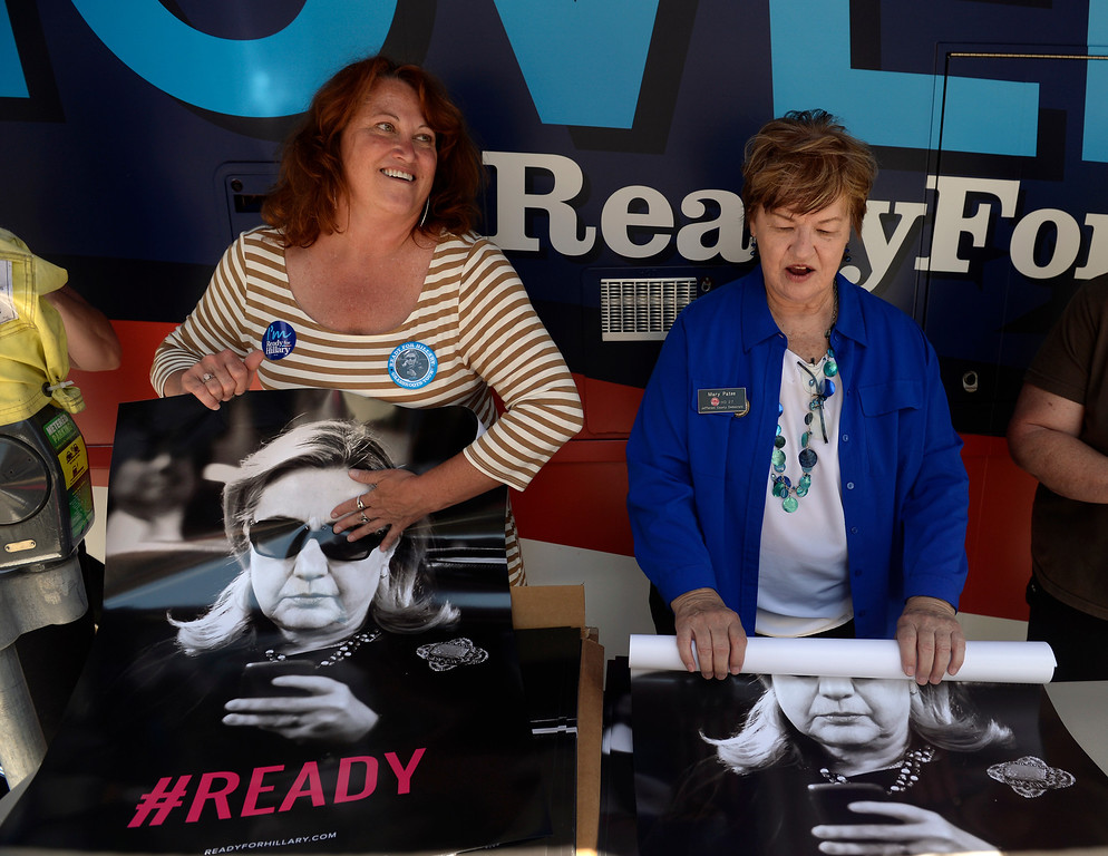 ". Mary Patee, right, and Christine Laursen from the Jefferson County Democrats, hand out posters of Hillary Clinton outside the Tattered Cover Bookstore. Hillary Rodham Clinton signs about 1,000 copies of her newly released book ""Hard Choices\"" for fans at the Tattered Cover Bookstore on E. Colfax Ave. in Denver on Monday, June 23, 2014. (Photo by Kathryn Scott Osler/The Denver Post)"