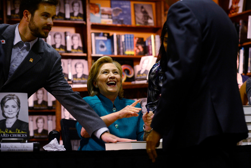 ". Hillary Rodham Clinton signs about 1,000 of her newly released book ""Hard Choices\"" for fans at the Tattered Cover Bookstore on E. Colfax Ave. in Denver on Monday, June 23, 2014. (Photo by Kathryn Scott Osler/The Denver Post)"