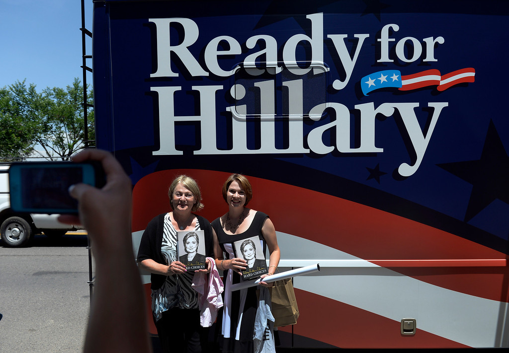 ". Holding their recently signed books, Kristina Mordecai, right and her mother Donna Riley have their photo taken outside the Tattered Cover Bookstore. Hillary Rodham Clinton signs about 1,000 copies of her newly released book ""Hard Choices\"" for fans at the Tattered Cover Bookstore on E. Colfax Ave. in Denver on Monday, June 23, 2014. (Photo by Kathryn Scott Osler/The Denver Post)"