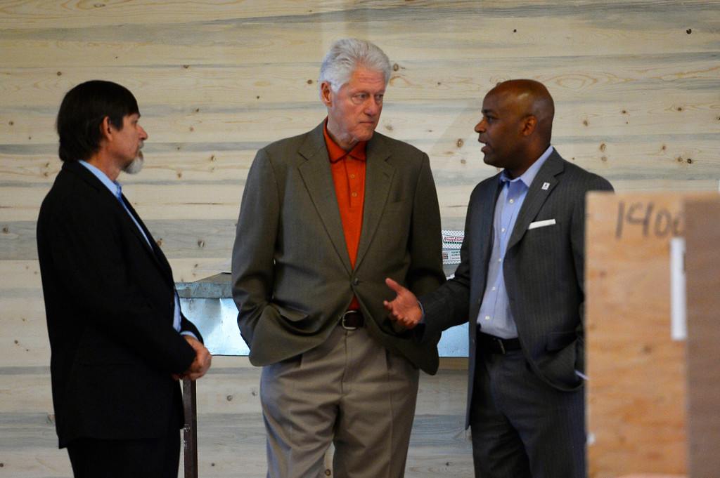 . President Bill Clinton with John Parvensky, President of the Colorado Coalition for the Homeless (L) and Mayor Michael Hancock, toured the new Stout Street Health Center and Renaissance Stout Street Lofts June 23, 2014, the latest development from the Colorado Coalition for the Homeless to address homelessness in Metro Denver.  The tour was in conjunction with the Clinton Global Initiative (CGI) America meeting in Denver. (Photo by John Leyba/The Denver Post)