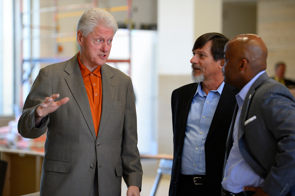 . President Bill Clinton with Mayor Michael Hancock and John Parvensky, President of the Colorado Coalition for the Homeless tour the new Stout Street Health Center and Renaissance Stout Street Lofts June 23, 2014, the latest development from the Colorado Coalition for the Homeless to address homelessness in Metro Denver.  The tour was in conjunction with the Clinton Global Initiative (CGI) America meeting in Denver. (Photo by John Leyba/The Denver Post)