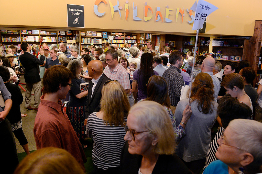 ". A crowd gathers and lines up to see Hillary Rodham Clinton and get their books signed Clinton is signing about 1,000 copies of her newly released book ""Hard Choices\"" for fans at the Tattered Cover Bookstore on E. Colfax Ave. in Denver on Monday, June 23, 2014. (Photo by Kathryn Scott Osler/The Denver Post)"