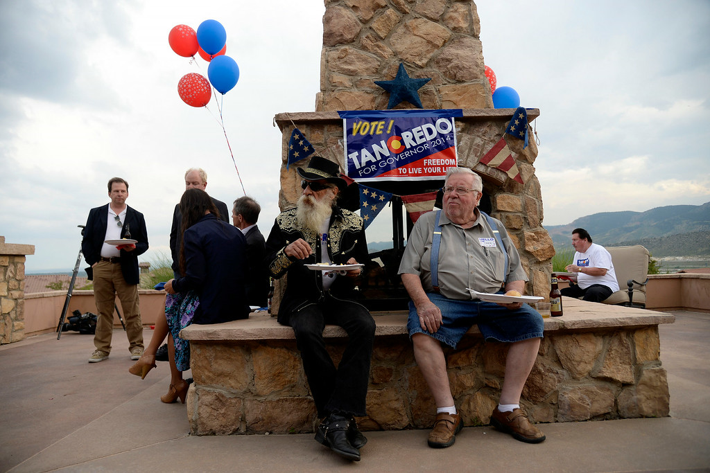 . Billy and Chuck (no last names provided) hang out during Tom Tancredo\'s Republican gubernatorial primary watch party. Tom Tancredo watch party on Tuesday, June 24, 2014. (Photo by AAron Ontiveroz/The Denver Post)