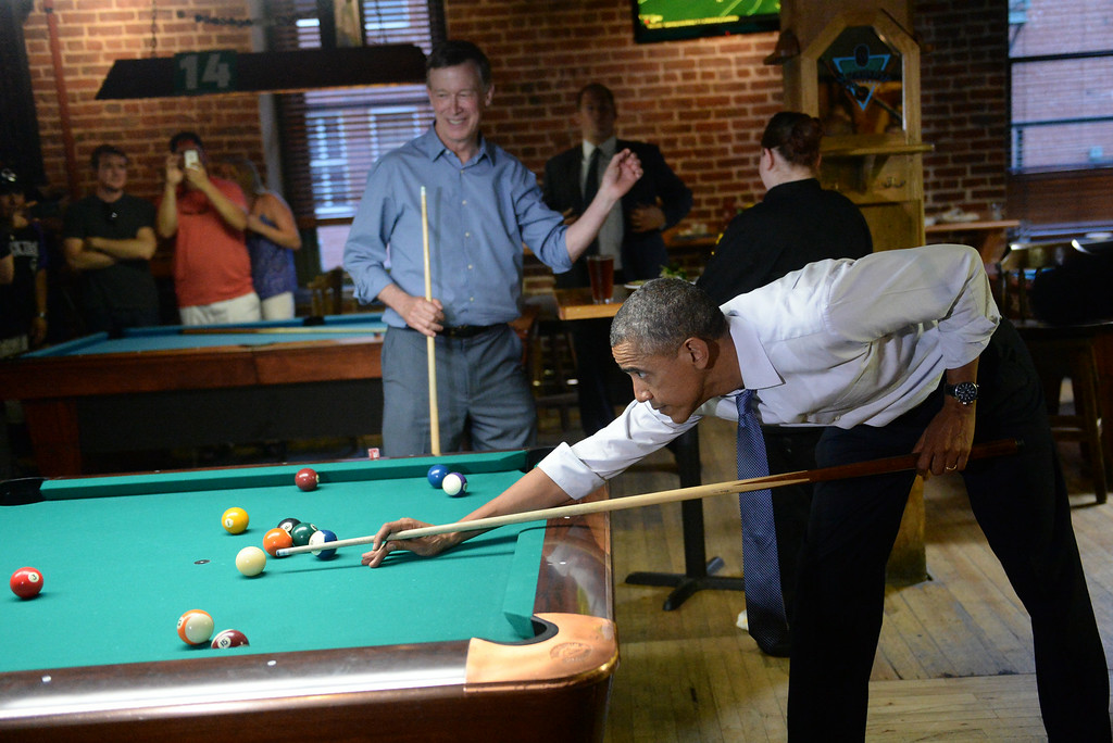 . DENVER, CO - JULY 08: President Barack Obama plays pool with Colorado Governor John Hickenlooper at Wynkoop Brewery in downtown Denver after arriving in Colorado, July 08, 2014. President Obama is in Colorado to speak about the economy and raise money for Senator Mark Udall\'s re-election campaign. (Photo by RJ Sangosti/The Denver Post)