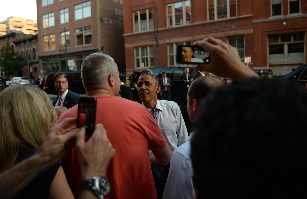 . DENVER, CO - JULY 08: President Barack Obama visits with people along 15th Street in downtown Denver after arriving in Colorado, July 08, 2014. President Obama is in Colorado to speak about the economy and raise money for Senator Mark Udall\'s re-election campaign. (Photo by RJ Sangosti/The Denver Post)