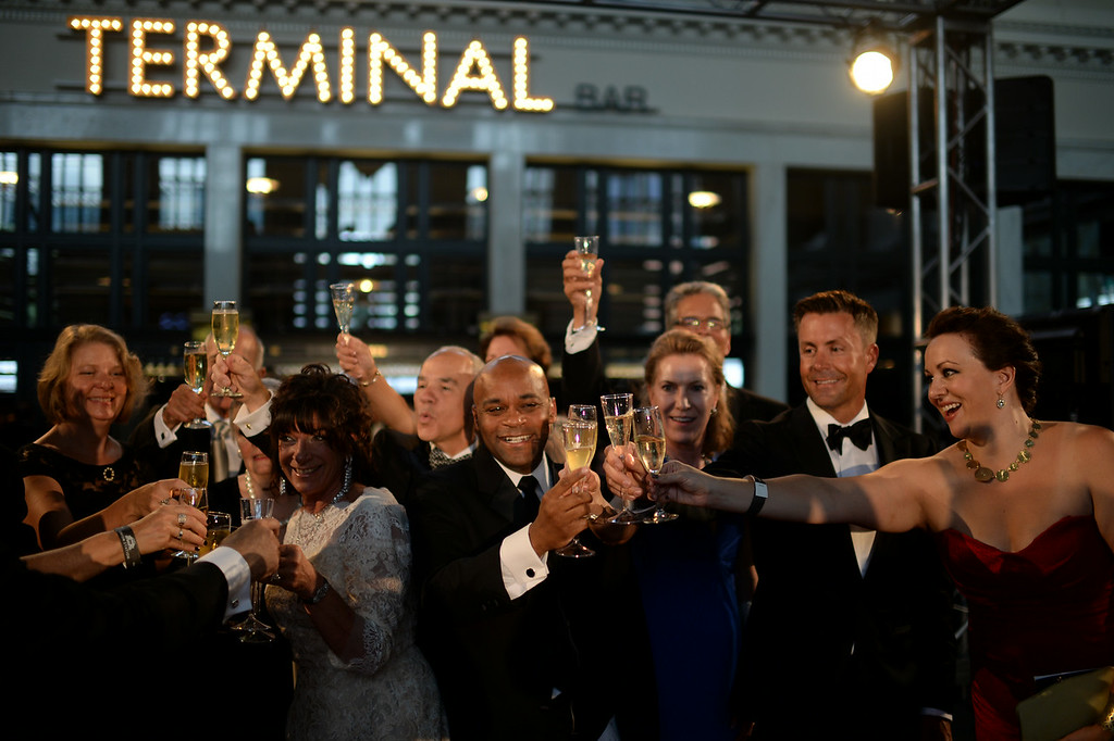 . DENVER, CO - JULY 11: Denver Mayor Michael Hancock, front, celebrates the Denver Union Station Great Hall Gala with other guests in Denver, Colorado July 11, 2014. Union Station is opening with the gala for 1,000 people paying $1,000 each to benefit 55 local charities.(Photo by Hyoung Chang/The Denver Post)
