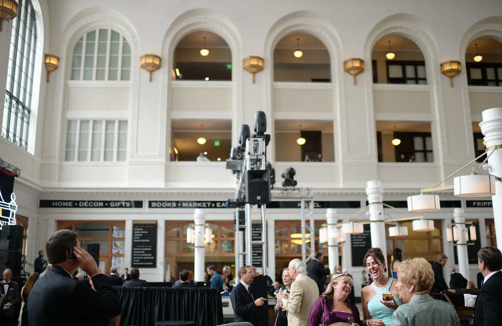 . DENVER, CO - JULY 11: People are celebrating during the Denver Union Station Great Hall Gala in Denver, Colorado July 11, 2014. Union Station is opening with the gala for 1,000 people paying $1,000 each to benefit 55 local charities.(Photo by Hyoung Chang/The Denver Post)