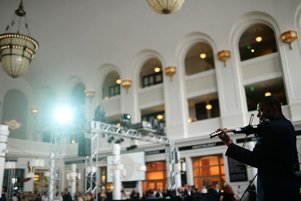 . DENVER, CO - JULY 11: Violinist Jeff Hughes performs duringthe Denver Union Station Great Hall Gala in Denver, Colorado July 11, 2014.  Union Station is opening with the gala for 1,000 people paying $1,000 each to benefit 55 local charities.(Photo by Hyoung Chang/The Denver Post)