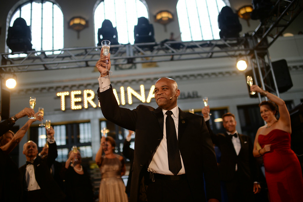 . DENVER, CO - JULY 11: Denver Mayor Michael Hancock celebrates the Denver Union Station Great Hall Gala in Denver, Colorado July 11, 2014. Union Station is opening with the gala for 1,000 people paying $1,000 each to benefit 55 local charities.(Photo by Hyoung Chang/The Denver Post)