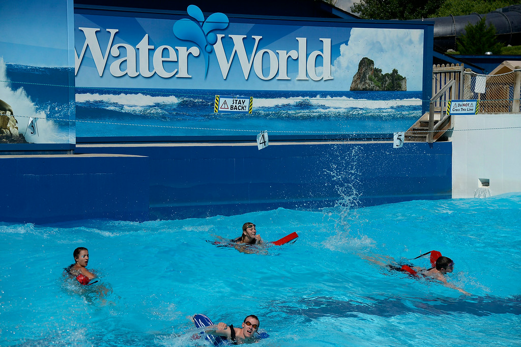 . Lifeguards competed in the inner tube relay with waves at Water World. More than 600 lifeguards proved their life-saving skills as they compete in the 29th Annual Colorado Parks & Recreation Association Lifeguard Games.   (Photo by John Leyba/The Denver Post)