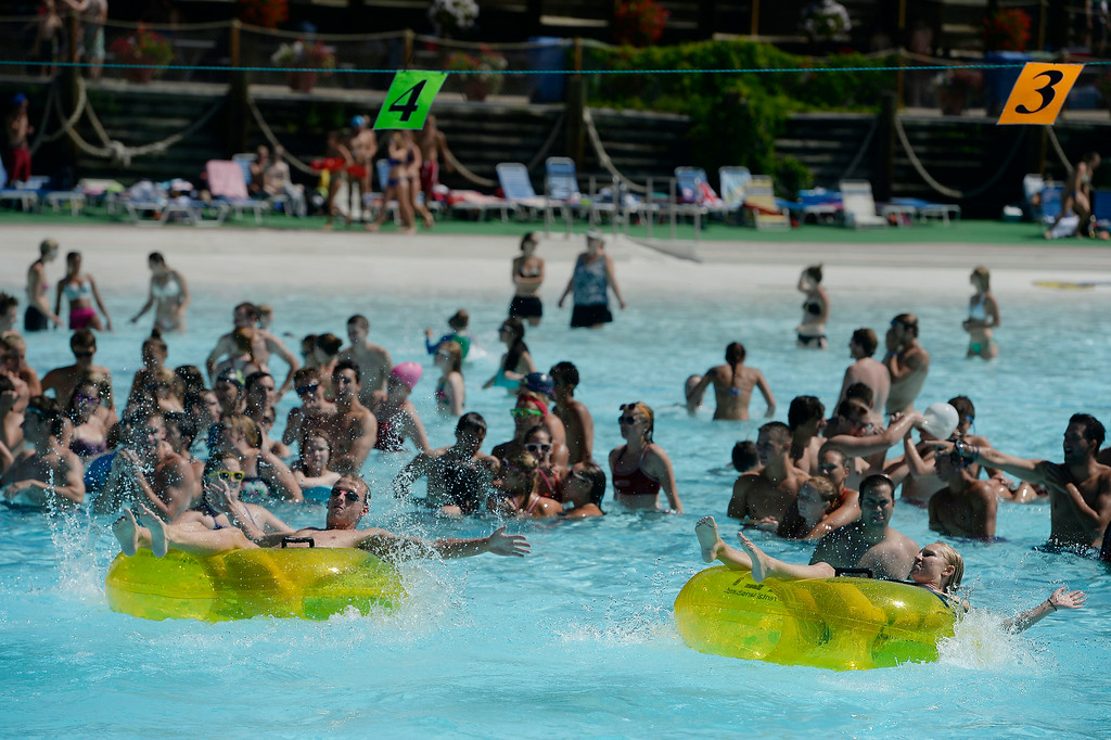 . Lifeguards competed in the Inner Tube Relay at Water World. More than 600 lifeguards proved their life-saving skills as they compete in the 29th Annual Colorado Parks & Recreation Association Lifeguard Games  July 13, 2014 at Hyland Hills Water World.    (Photo by John Leyba/The Denver Post)