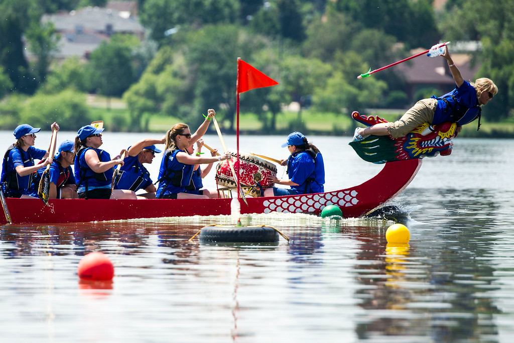 . Laura McFadden, flag puller for Team Security Service One pulls the flag in a race with Team Seas The Dragon! during the 2014 Colorado Dragon Boat Festival at Sloan\'s Lake Park on Sunday, July 20, 2014 in Denver, CO.  The event featured 100 performances on 5 stages, 21 food vendors in two food Taste of Asia courts, more than 40 Marketplace Exhibitors, and the exciting ancient sport of Dragon Boat Racing.  (Photo by Kent Nishimura/The Denver Post)