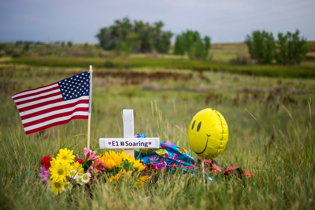. A roadside memorial honoring the young eaglet that died is seen along E120th Avenue near, E-470 on Sunday, July 27, 2014 in Commerce City, Colorado.  The memorial was erected by Jamie Miles, in honor of the young eaglet, on Thursday, July 24, 2014.  (Photo by Kent Nishimura/The Denver Post)
