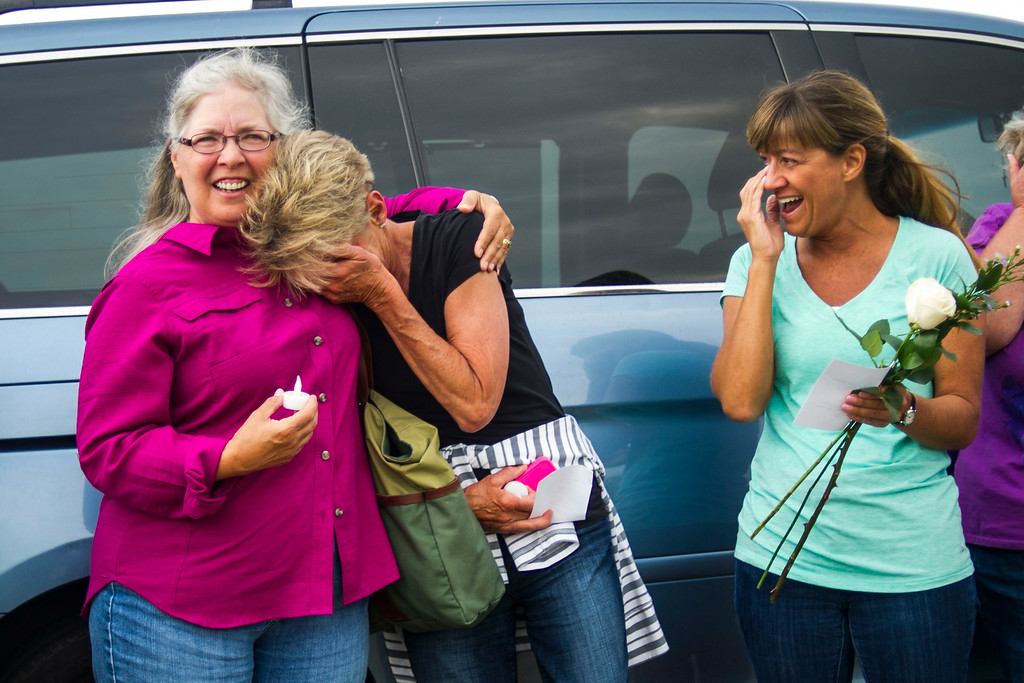 . Volunteers Karen Tonso, Linda Chambers and Dorotohy Gibson share a light moment during a gathering to honor the young eaglet that died last week at an eagle\'s nest along E120th Avenue near, E-470 on Sunday, July 27, 2014 in Commerce City, Colorado.  (Photo by Kent Nishimura/The Denver Post)