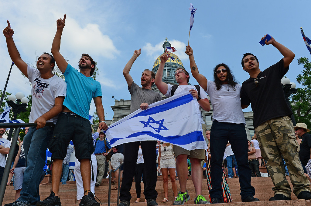 . Pro-Israeli supporters sing the Israeli national anthem in front of  Palestinian supporters on the other side of Broadway during  a pro-Israel rally on the west steps of the state Capitol in Denver, CO  on July 27, 2014.  (Photo By Helen H. Richardson/ The Denver Post)