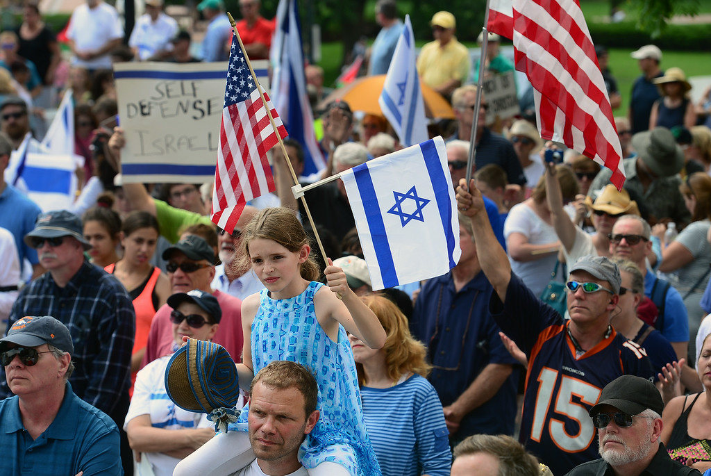 . Ettie Geltser, 8, sits on her father Ilia\'s shoulders as they and a few hundred others  took part in a pro-Israel rally on the west steps of the state Capitol in Denver, CO  on Sunday, July 27, 2014. (Photo By Helen H. Richardson/ The Denver Post)