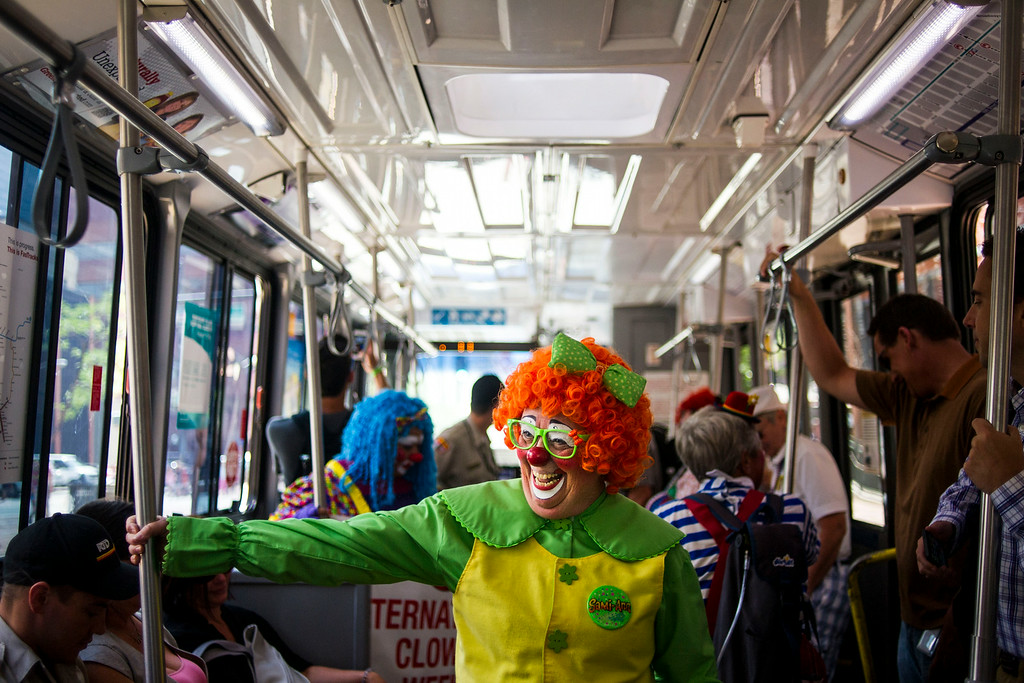 . DENVER, CO - AUGUST 04:  Kathy Shook, Sami-Ann the Clown, rides the Mall Ride with other members of the Colorado Clown Alley along the 16ht Street Mall on Monday, August 04, 2014 in Denver, Colorado.   The members of the Colorado Clown Alley were out at Union Station and the 16th Street Mall in celebration of International Clown Week which runs from August 1-7.  (Photo by Kent Nishimura/The Denver Post)