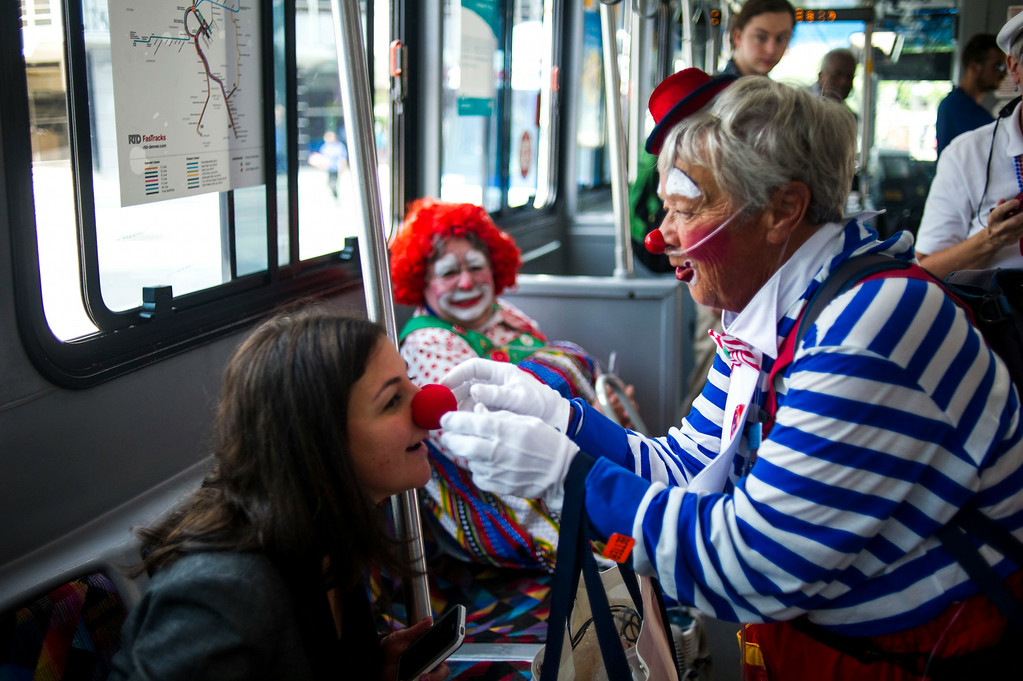 . DENVER, CO - AUGUST 04:  Pamela Maass receives a nose from Fran Etzkorn, Kolo the Clown, at Union Station on Monday, August 04, 2014 in Denver, Colorado.  The members of the Colorado Clown Alley were out at Union Station and the 16th Street Mall in celebration of International Clown Week which runs from August 1-7.  (Photo by Kent Nishimura/The Denver Post)