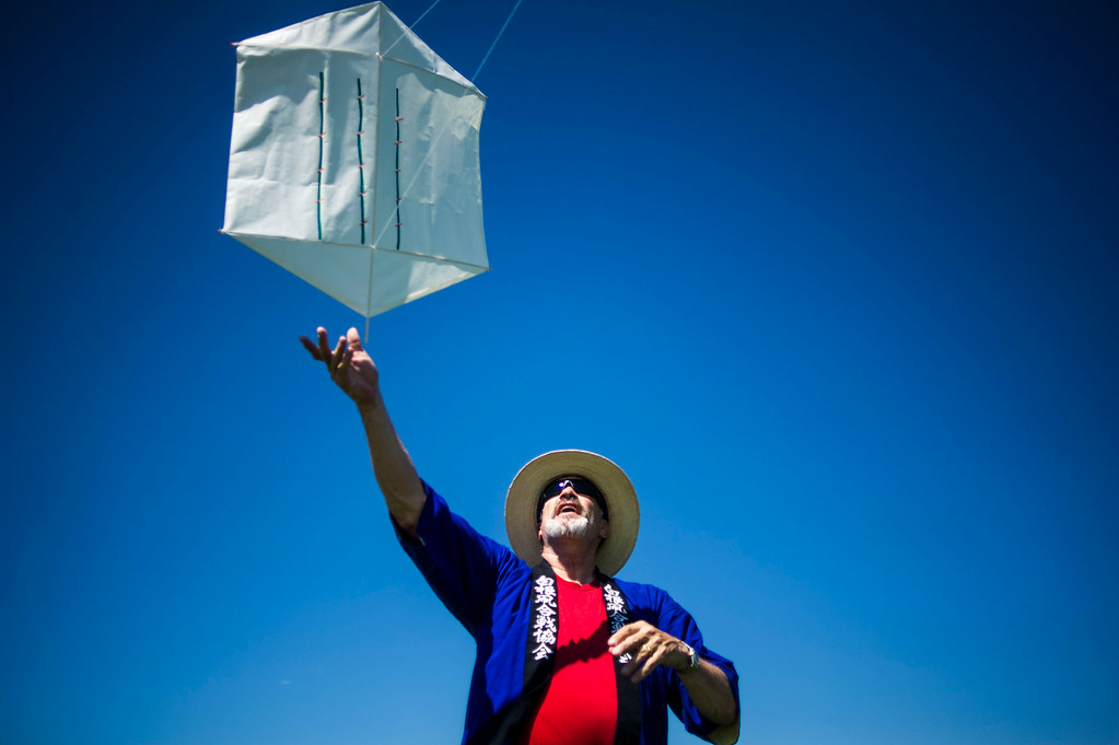 . DENVER, Colorado - AUGUST 06:  Scott Skinner helps a kite take flight during the Japanese Kite Festival at the Pavilion at Stapleton Central Park on Wednesday, August 06, 2014 in Denver, Colorado.  The event featured a demonstration by Japanese Kite Master Mikio Toki of Japan and a chance to make your own kites.  (Photo by Kent Nishimura/The Denver Post)