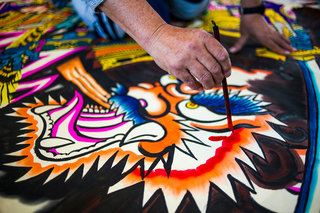 . DENVER, Colorado - AUGUST 06:  Japanese Kite Master Mikio Toki paints during a demonstration at the Japanese Kite Festival at the Pavilion at Stapleton Central Park on Wednesday, August 06, 2014 in Denver, Colorado.  The event featured a demonstration by Japanese Kite Master Mikio Toki of Japan and a chance to make your own kites.  (Photo by Kent Nishimura/The Denver Post)