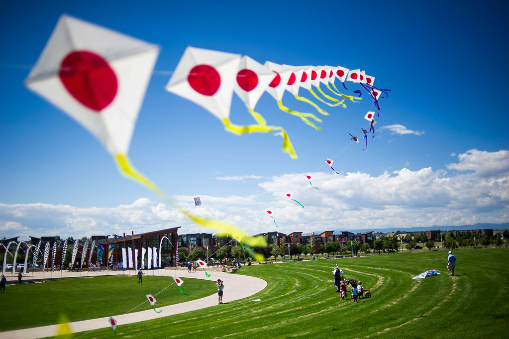 . DENVER, Colorado - AUGUST 06:  Japanese Kite Master Mikio Toki flies a kite train or Rendako, made up of 150 individually connected kites, during the Japanese Kite Festival at the Pavilion at Stapleton Central Park on Wednesday, August 06, 2014 in Denver, Colorado.  The event featured a demonstration by Japanese Kite Master Mikio Toki of Japan and a chance to make your own kites.  (Photo by Kent Nishimura/The Denver Post)
