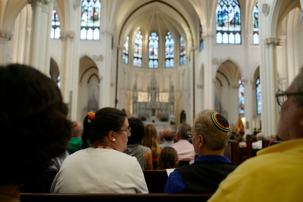 . People gather in prayer and peace during an inter-faith gathering. The Place Initiative: Peace, Love and Co-Existence, an inter-faith assembly, was photographed on Monday, August 11, 2014. (Photo by AAron Ontiveroz/The Denver Post)