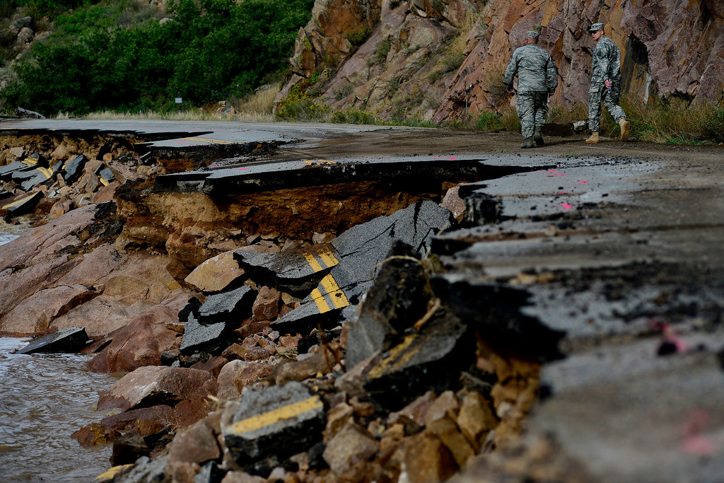 . A section of damaged road during a tour to look at the damage caused by recent flooding in the area on U.S. Highway 36 between Lyons and Pinewood Springs. Large sections of the roadway are completely missing, while others are severely damaged making travel impossible by way of motor vehicle in spots. (Photo by AAron Ontiveroz/The Denver Post)
