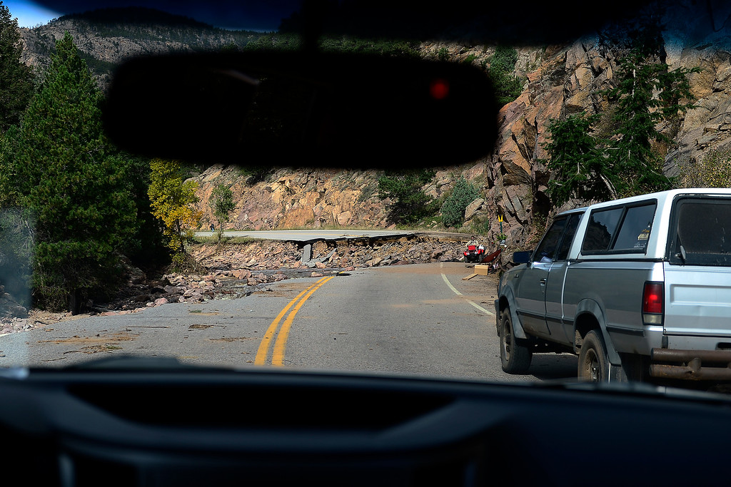 . PINEWOOD SPRINGS, CO - SEPTEMBER 22: A view of a missing section of road from the inside of resident Forrest Snider\'s Subaru during a tour to look at the damage caused by recent flooding in the area on U.S. Highway 36 between Lyons and Pinewood Springs. Pavement is missing in many section of the road that connects Lyons to Estes Park. (Photo by AAron Ontiveroz/The Denver Post)