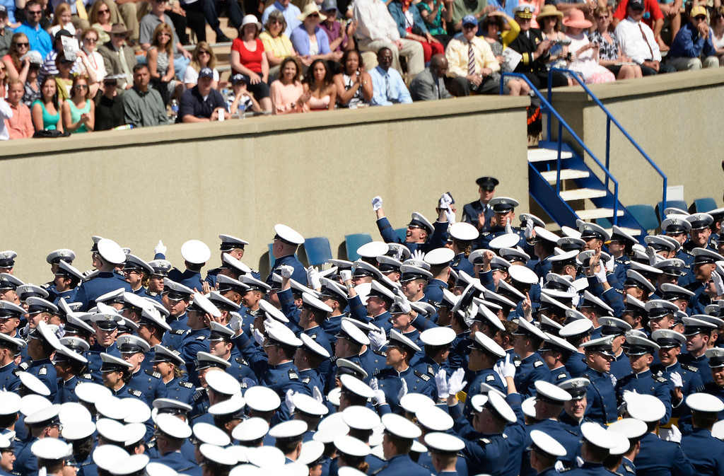 . The class of 2014 cadets turn and wave to their family in the  stadium during the commencement ceremony at Air Force Academy in Colorado Spring, May 28, 2014. (Photo by RJ Sangosti/The Denver Post)