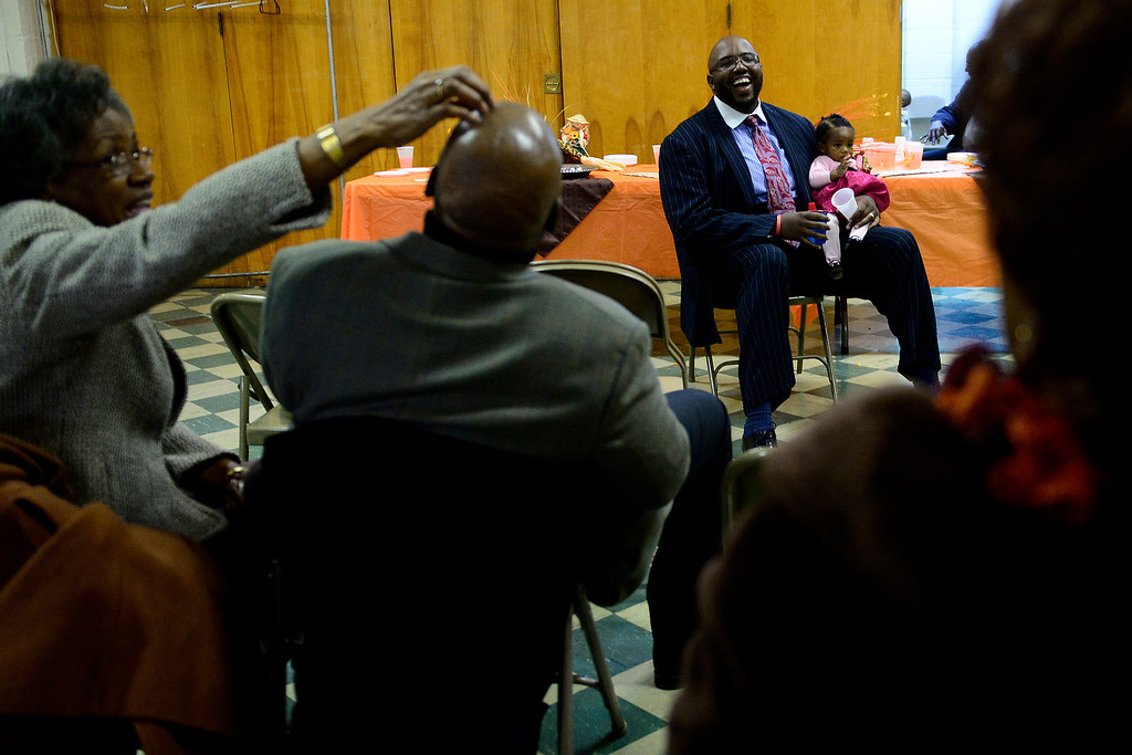. Barbara Edmonds swats the head of her husband Fred Tater Edmonds after he asked pastor Victor Lane whether he was a Broncos fan during a meeting with church members after the Sunday service at Macedonia Baptist church in Denver on November 24, 2013. Pastor Victor-LaMonte Lane was installed as the new pastor of Macedonia Baptist church on December 6, 2013. (Photo by AAron Ontiveroz/The Denver Post)