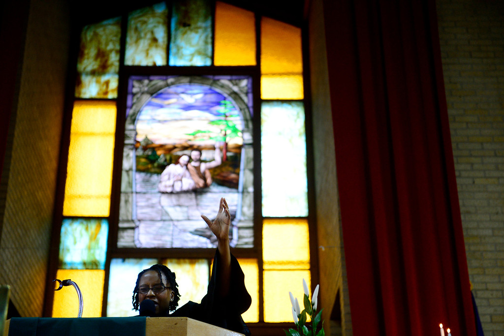 . Taihesaia Lane delivers a sermon during a Sunday service at Macedonia Baptist church in Denver on November 24, 2013. Lane\'s husband, Victor, was installed as the new pastor of the church on December 6, 2013. (Photo by AAron Ontiveroz/The Denver Post)