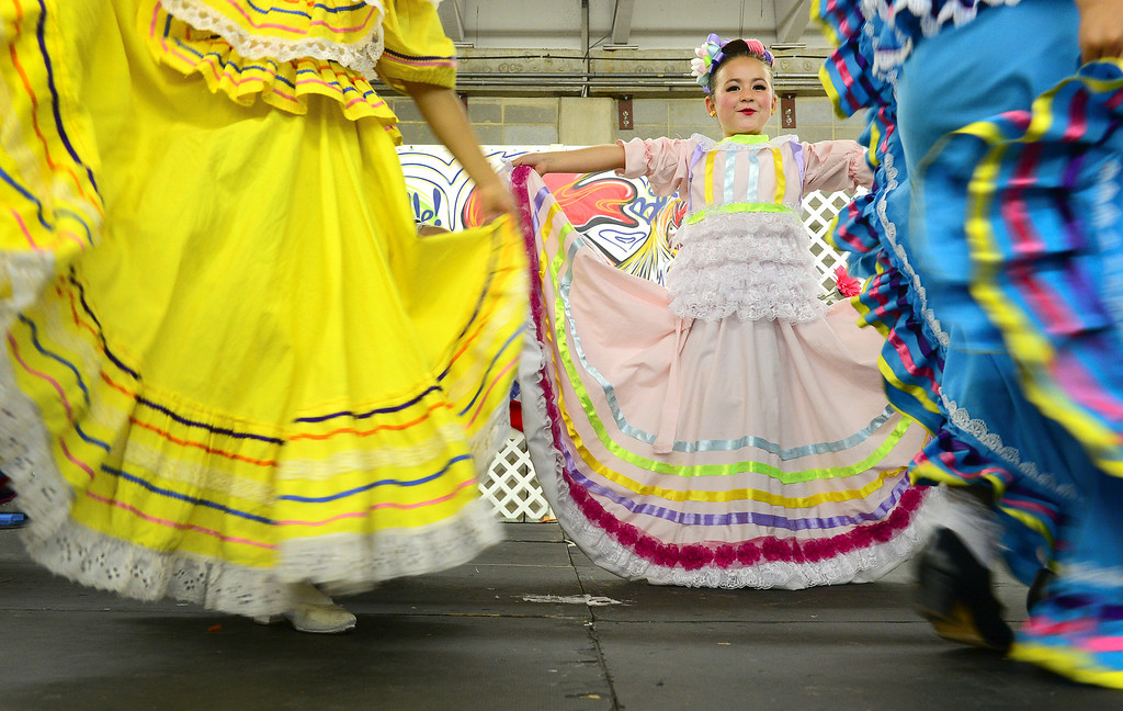 . Norma Dominguez, 5, and other dancers with Folklorico Dance perform at the Denver County Fair at the National Western Complex in Denver, CO on August 3rd, 2014. This was the last day of the fair which included dancing, singing, dog agility courses, freak shows, and pie eating contests. (Photo by Helen H. Richardson/The Denver Post)